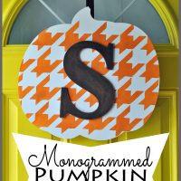 Try a hanging door sign instead of a wreath. Learn how to make this easy monogrammed pumpkin door decor for fall at Sparkles of Sunshine.